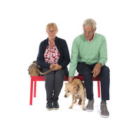 Couple in waiting room with senior dog