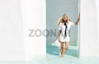 Cheerful female in white clothes on resort terrace
