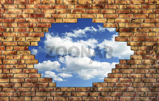 Brick wall with break trough to see the blue sky with clouds