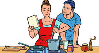 Husband and wife cook in the kitchen