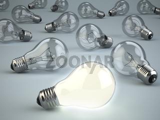 Idea concept. Light bulbs on grey background.
