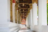 View to corridor with columns and lanterns in Temple of Emerald Buddha