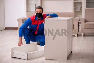 Young carpenter working indoors during pandemic disease
