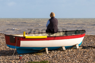 WORTHING, WEST SUSSEX/UK - NOVEMBER 13 : Lady sitting on a rowing boat in Worthing West Sussex on November 13, 2018. One unidentified woman