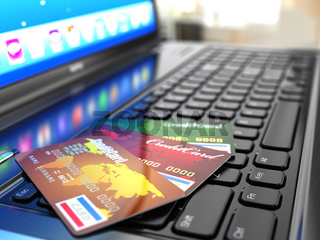 Online purchase. Credit card on laptop keyboard.