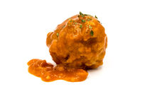 Meatball cooked in tomato sauce with