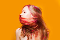 Stylish woman shaking head on yellow background