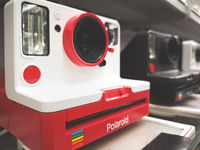 red Polaroid instant camera iconic eighties design object