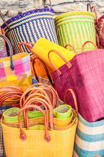 Stand with colorful bags in the market in Gordes