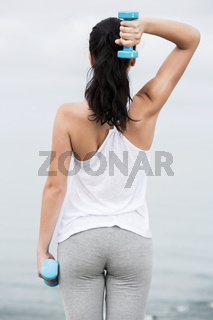 Woman doing exercises with weights