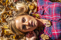 A Lovely Blonde Model Enjoys An Autumn Day Outdoors At The Park