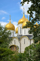 Historic church with golden dome inside the Kremlin gardens