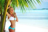 Woman in bikini under palm