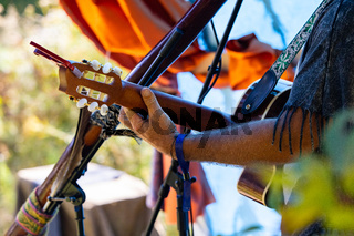 Guitar player on stage at earth festival