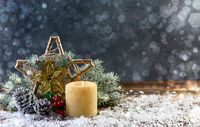 Festive composition with a Christmas star and a burning candle.