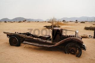 Old Timer Car Wrecks in a Desert Landscape