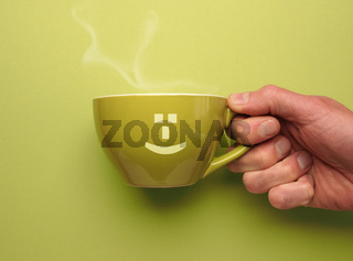 Green coffee mug with a smiling icon