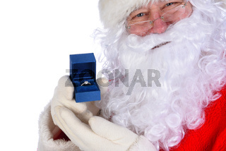 Santa Claus holding a diamond engagement ring in a blue box closeup next to his face.