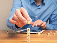 Concepual business image with small wooden blocks