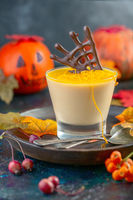Pumpkin Panna cotta with orange jelly and chocolate decor.