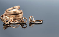 Elegant women's gold jewelry of different shapes
