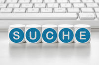 Letter dice in front of a keyboard - Search - Suche German