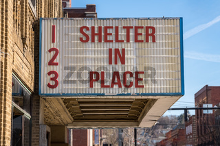 Recommendations to Shelter in Place to avoid Coronavirus on cinema board