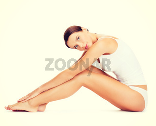 woman in cotton underwear doing exercises