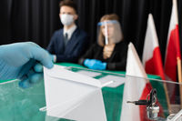 The young voter throws into the ballot box his votes for the new candidate for the new president of Poland.