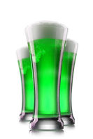 Green beer in glasses isolated on a white background.