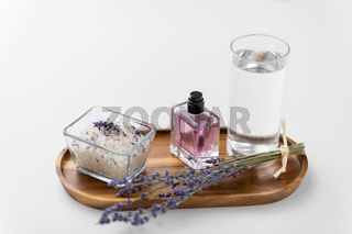 sea salt, perfume and lavender on wooden tray