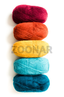 The different colored threads in trendy colors isolated on white