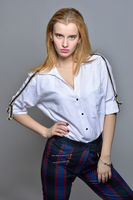 beautiful blonde woman in white shirt and checked trousers
