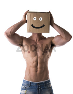 Muscular shirtless bodybuilder with smiling cardboard box on his head