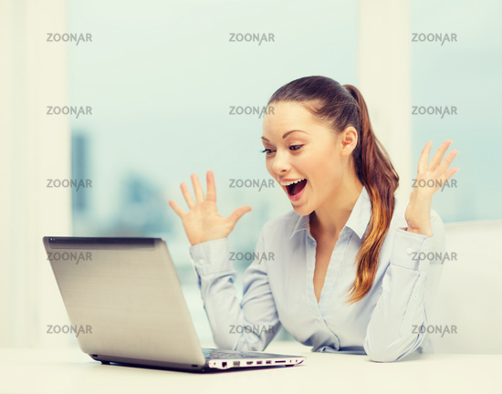 surprised businesswoman with laptop