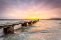 Sunset sky and long timber jetty