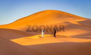 Two Berbers in Sahara desert, Merzouga, Morocco