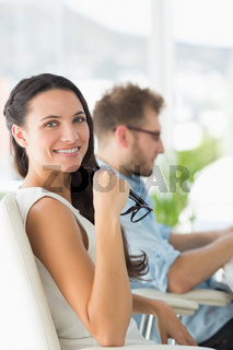 Beautiful designer smiling at camera