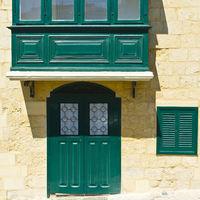 Balcony and door in Valletta.