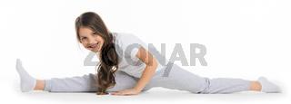 Little cute girl sitting in the splits