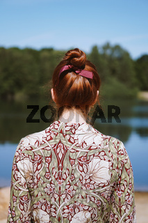 rear view of young woman alone in nature