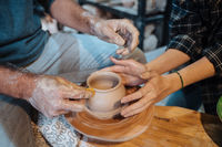 Making a handmade clay pot. Pottery lesson, hobby.