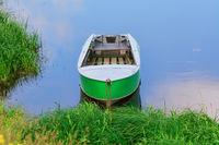 Metal rowboat on the lake
