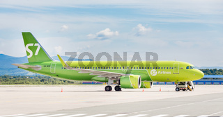Russia, Vladivostok, 08/17/2020. Passenger plane Airbus A320neo of S7 Airlines on runway after landing in sunny day. Happy journey and vacation concept. Aviation and transportation.