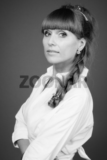 Portrait of young beautiful businesswoman in black and white