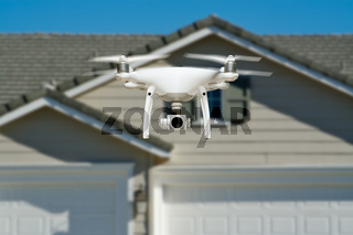 Unmanned Aircraft System Quadcopter Drone In The Air Near House