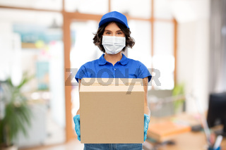 delivery woman in mask with parcel box at office