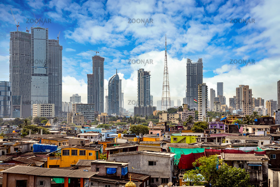 Views of slums on the shores of mumbai, India against the backdrop of skyscrapers under construction