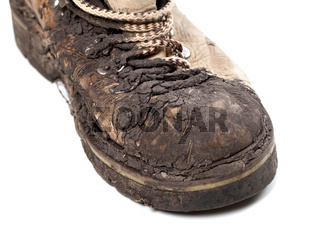 Part of old dirty hiking boot on white background