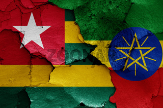flags of Togo and Ethiopia painted on cracked wall